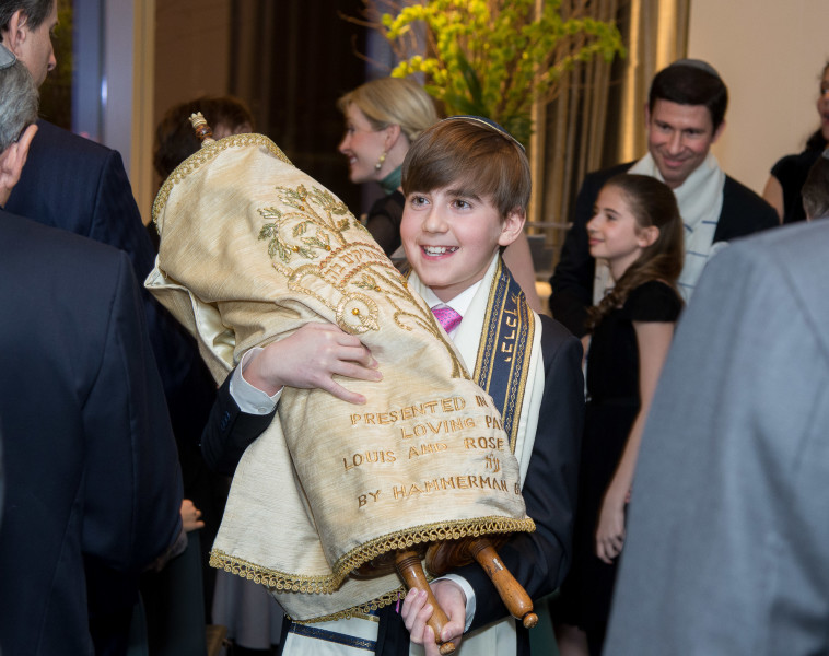 Ben Asen Celebration Photo: Bar Mitzvah boy holding the torah