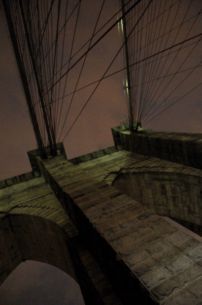 Ben Asen Personal Work Photo: Color photo of Brooklyn Bridge arch and cables at night in Brooklyn New York
