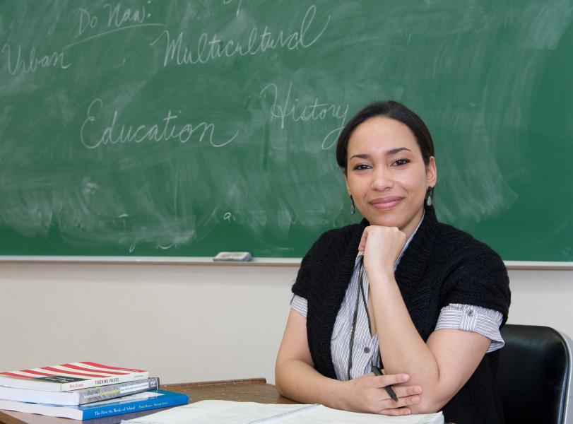 Ben Asen Portrait Photo: College of Mount Saint Vincent Associate Professor in front of blackboard