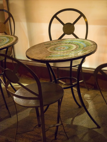 Ben Asen Personal Work Photo: Color photo of cafe chairs with mosaic top table at night.