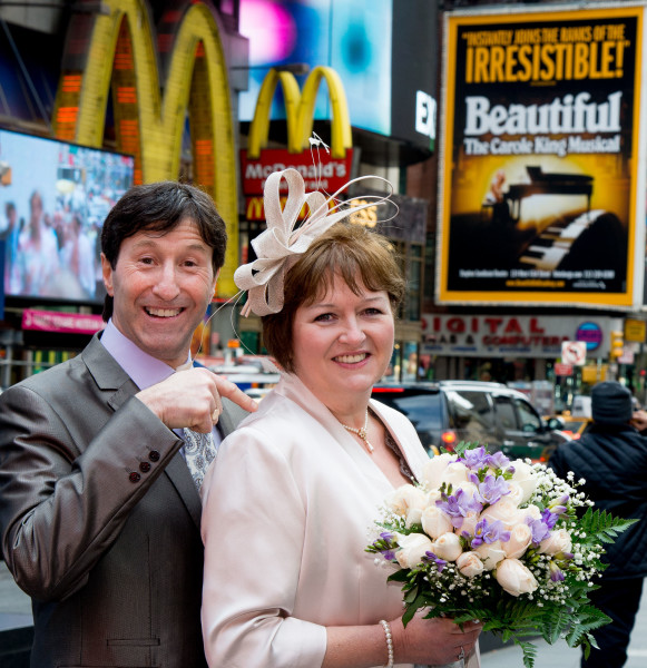 Ben Asen Celebration Photo: Bride and groom in Times Square New York with sign saying irresistible and beautiful