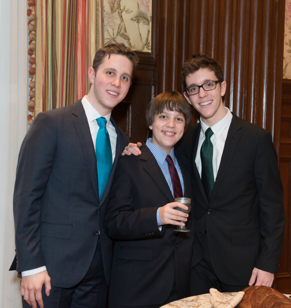 Ben Asen Celebration Photo: Bar Mitzvah boy with his 2 brothers with kiddush wine cup and challah