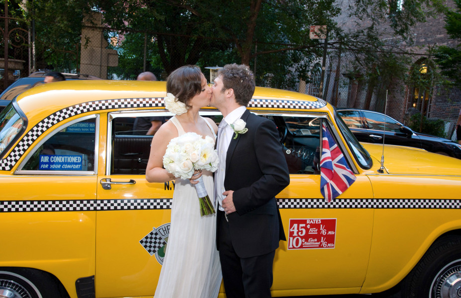 Ben Asen Celebration Photo: Color photo of bride and groom kissing in front of New York City Checker cab with a British fag