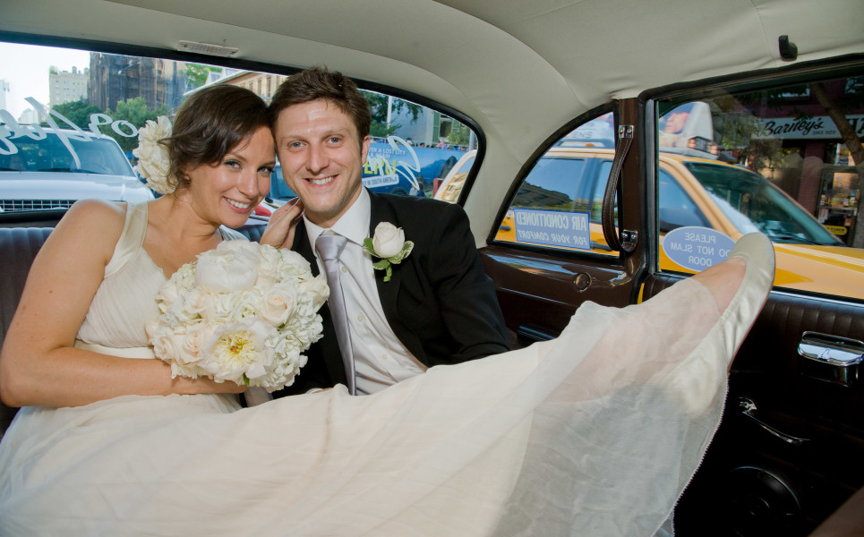 Ben Asen Celebrations Photo: Color photo of bride and groom sitting in a New York City taxi