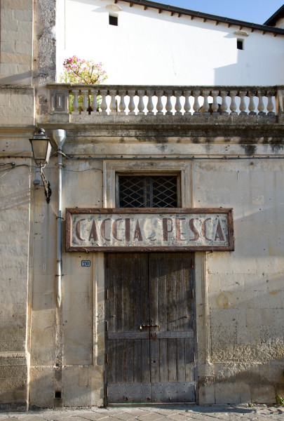Ben Asen Personal Work Photo: Color photo of a restaurant named Caccia e Pesce in Galantina, in the Puglia region of Italy.