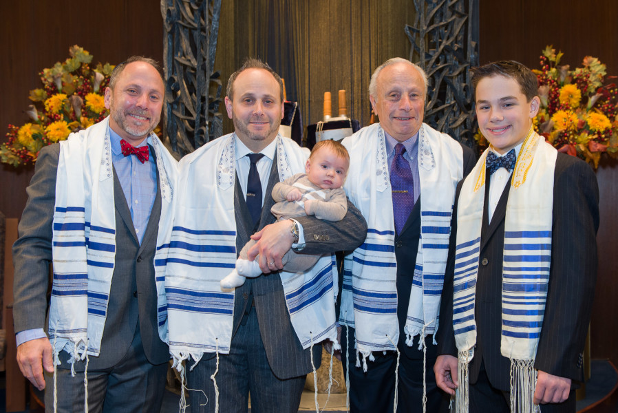 Ben Asen Celebration Photo: Bar Mitzvah boy with father, grandfather, Uncle and baby cousin in synagogue