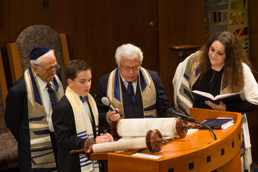 Ben Asen Celebration Photo: Bar Mitzvah boy chanting haftorah in synagogue