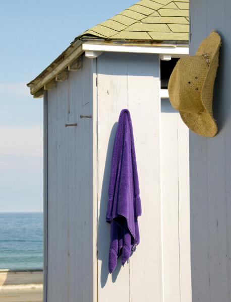 Ben Asen Personal Work Photo: Color photo of beach cabana with hanging purple towel and straw mens style cowboy hat with ocean in the background.