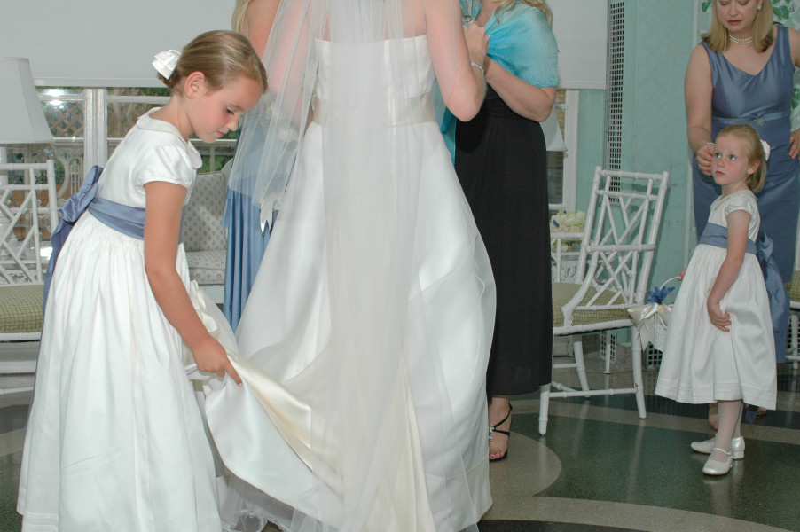 Ben Asen Celebrations Photo: Bride getting ready for wedding ceremony with flower girls