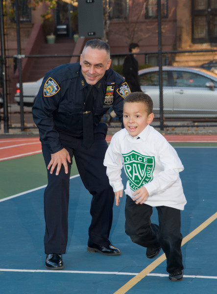 Ben Asen Editorial Photo: Police Athletic League (PAL) of NYC, with a PAL Police Officer with a Young Boy