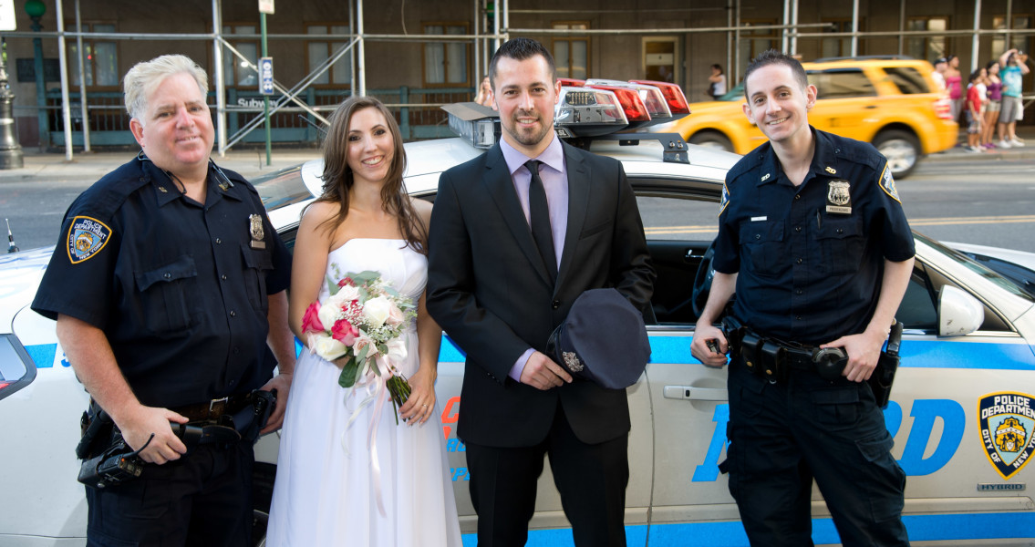 Ben Asen Celebrations Photo: Bride and groom posing with New York City Police in front of patrol car