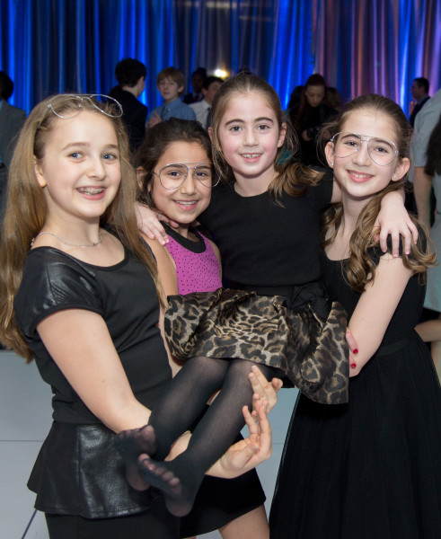 Ben Asen Celebration Photo: 3 girls holding up the sister of a bar mitzvah boy at the bar mitzvah party