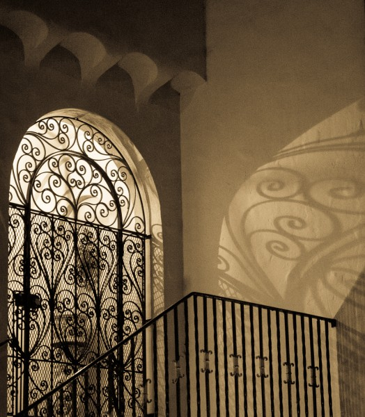 Ben Asen Personal Work Photo: black and white sepia toned photo ofshadow and light in doorway inSan Francisco California