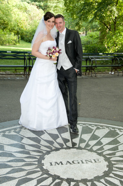Ben Asen Celebrations Photo: Bride and groom standing in Strawberry Fields on the John Lennon Imagine Memorial in New York City Central Park for a wedding