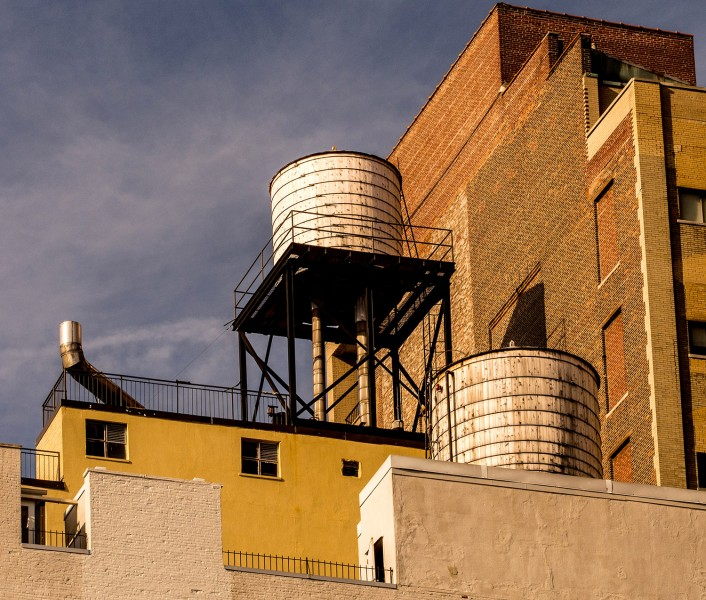 color photo two white water towers, Chelsea, Manhattan New York City
