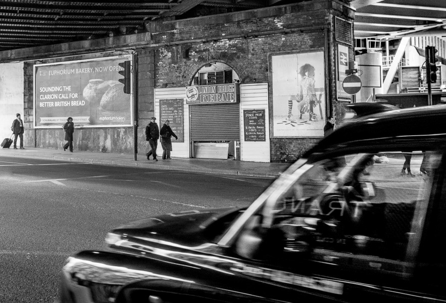 Ben Asen Personal Work Photo: black and white photo of people walking London England with black car in the foreground