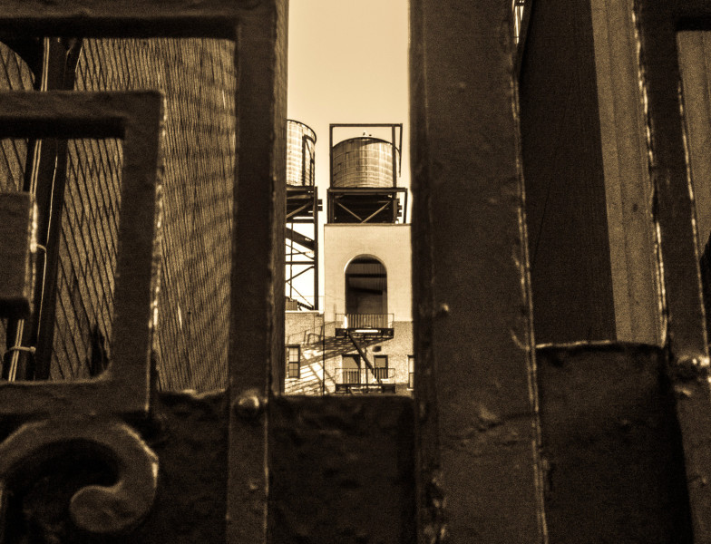 Ben Asen Personal Work: Black and white photo looking through gate at New York City Water Tower