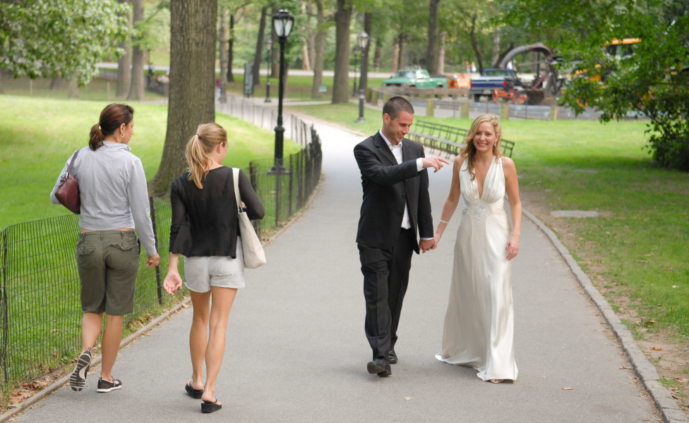 Ben Asen Celebration Photo: Bride and groom strolling through Central Park New York City
