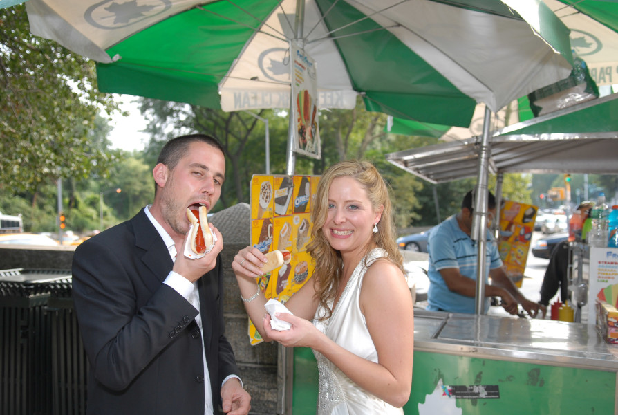Ben Asen Celebration Photo: Bride and groom eating a hotdog in Central Park New York City